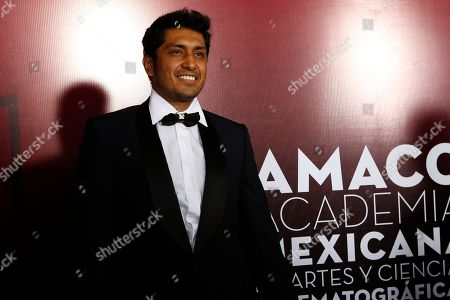Stock Image of Mexican actor Tenoch Huerta poses during the red carpet arrivals for the 61st edition of the Ariel Awards from the Mexican Academy of Arts and Cinematographic Sciences at the National Cineteca in Mexico City