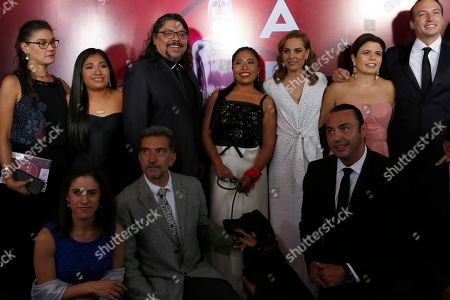 Stock Photo of Mexican actress Yalitza Aparicio, center, and Marina de Tavira, center right, pose with the cast and crew of Roma during the red carpet arrivals for the 61st edition of the Ariel Awards hosted by the Mexican Academy of Arts and Cinematographic Sciences, at the National Cineteca in Mexico City
