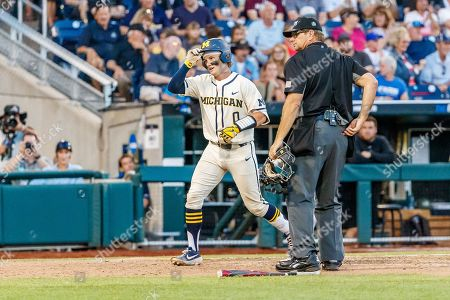 Omaha, NE U.S. - Michigan's Joe Donovan #0 steps on home plate after his home run in action during game 1 of the NCAA Men's College World Series between Michigan Wolverines and Vanderbilt Commodores at the TD Ameritrade Park in Omaha, NE..Attendance: 24,707.Michigan won 7-3