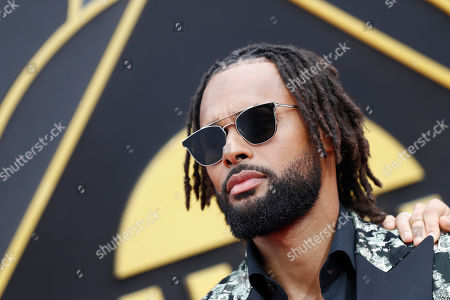 Australian basketball player Patty Mills poses for photographers upon his arrival for the 2019 NBA Awards at Barker Hangar in Santa Monica, California, USA, 24 June 2019. The 2019 NBA Awards will be the 3rd annual awards show by the National Basketball Association (NBA).