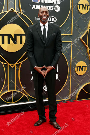 Former US basketball player John Salley poses for photographers upon his arrival for the 2019 NBA Awards at Barker Hangar in Santa Monica, California, USA, 24 June 2019. The 2019 NBA Awards will be the 3rd annual awards show by the National Basketball Association (NBA).