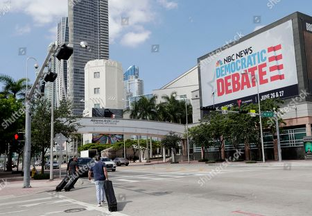 Stock Photo of A billboard advertises the Democratic Presidential Debates across from the Knight Concert Hall at the Adrienne Arsht Center for the Performing Arts of Miami-Dade County, in Miami. Don't envy NBC News executive Rashida Jones, who is behind this week's inaugural Democratic presidential debate and will have to juggle 20 candidates, five news personalities and, it's likely, one tweeting president