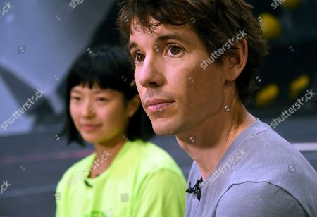 "Rock climbers Alex Honnold, right, and Ashima Shiraishi are interviewed at the Earth Treks gym in Englewood, Colo. Honnold is trying to get a grip on life in the aftermath of the Academy Award winning documentary ""Free Solo."" His fear is that maybe his 2017 ropeless climb of El Capitan in Yosemite featured in the spine-tingling film just might be the summit of his career"