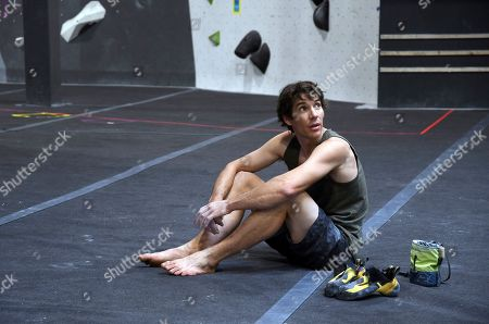 "Professional rock climber Alex Honnold sits on the padded floor at the Earth Treks gym in Englewood, Colo. Honnold is trying to get a grip on life in the aftermath of the Academy Award winning documentary ""Free Solo."" His fear is that maybe his 2017 ropeless climb of El Capitan in Yosemite featured in the spine-tingling film just might be the summit of his career"