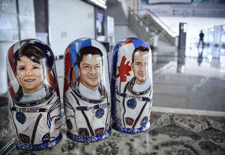 Russian traditional wooden dolls 'matryoshka' depicting NASA astronaut Anne McClain, Russian cosmonaut Oleg Kononenko and David Saint-Jacques of the Canadian Space Agency are seen at a press conference hall in Karaganda, Kazakhstan, 25 June 2019. The Soyuz MS-11 capsule with the International Space Station (ISS) crew of NASA astronaut Anne McClain, Russian cosmonaut Oleg Kononenko and David Saint-Jacques of the Canadian Space Agency on board landed in the Kazakh steppe on 25 June 2019.