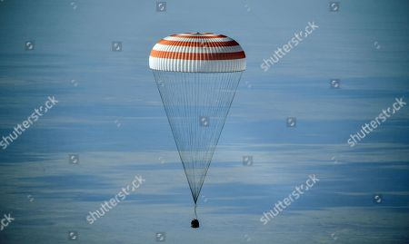 Stock Picture of The Soyuz MS-11 capsule carrying the International Space Station (ISS) crew of NASA astronaut Anne McClain, Russian cosmonaut Oleg Kononenko and David Saint-Jacques of the Canadian Space Agency, descends beneath a parachute before landing in a remote area outside the town of Dzhezkazgan (Zhezkazgan), Kazakhstan, 25 June 2019.