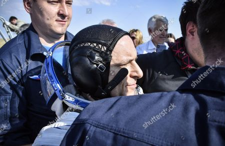 Stock Photo of Ground personnel carry David Saint-Jacques of the Canadian Space Agency shortly after landing in a remote area outside the town of Dzhezkazgan (Zhezkazgan), Kazakhstan, 25 June 2019. The Soyuz MS-11 capsule with the International Space Station (ISS) crew of NASA astronaut Anne McClain, Russian cosmonaut Oleg Kononenko and David Saint-Jacques of the Canadian Space Agency on board landed in the Kazakh steppe on 25 June 2019.