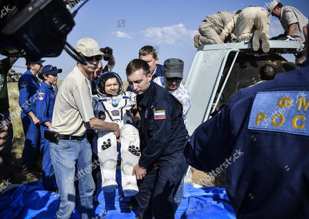 Ground personnel carry Russian cosmonaut Oleg Kononenko shortly after landing in a remote area outside the town of Dzhezkazgan (Zhezkazgan), Kazakhstan, 25 June  2019.  The Soyuz MS-11 capsule with the International Space Station (ISS) crew of NASA astronaut Anne McClain, Russian cosmonaut Oleg Kononenko and David Saint-Jacques of the Canadian Space Agency on board landed safly in the Kazakh steppe on 25 June 2019.
