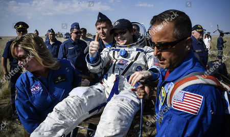 Ground personnel carry NASA astronaut Anne McClain shortly after landing in a remote area outside the town of Dzhezkazgan (Zhezkazgan), Kazakhstan, 25 June  2019.  The Soyuz MS-11 capsule with the International Space Station (ISS) crew of NASA astronaut Anne McClain, Russian cosmonaut Oleg Kononenko and David Saint-Jacques of the Canadian Space Agency on board landed safly in the Kazakh steppe on 25 June 2019.