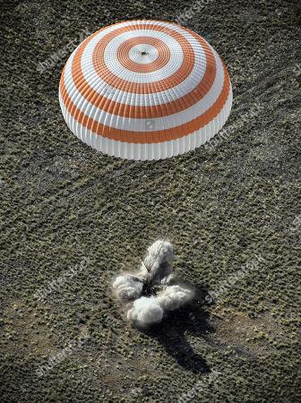 The Soyuz MS-11 capsule carrying the International Space Station (ISS) crew of NASA astronaut Anne McClain, Russian cosmonaut Oleg Kononenko and David Saint-Jacques of the Canadian Space Agency, lands in a remote area outside the town of Dzhezkazgan (Zhezkazgan), Kazakhstan, 25 June  2019.