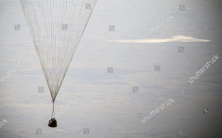 The Soyuz MS-11 capsule carrying the International Space Station (ISS) crew of NASA astronaut Anne McClain, Russian cosmonaut Oleg Kononenko and David Saint-Jacques of the Canadian Space Agency, descends beneath a parachute before landing in a remote area outside the town of Dzhezkazgan (Zhezkazgan), Kazakhstan, 25 June  2019.