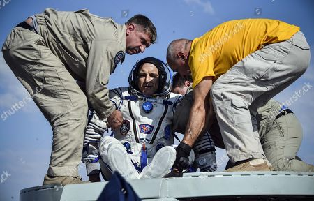 Ground personnel help David Saint-Jacques of the Canadian Space Agency to get out of the Soyuz MS-11 capsule shortly after landing in a remote area outside the town of Dzhezkazgan (Zhezkazgan), Kazakhstan, 25 June  2019.  The Soyuz MS-11 capsule with the International Space Station (ISS) crew of NASA astronaut Anne McClain, Russian cosmonaut Oleg Kononenko and David Saint-Jacques of the Canadian Space Agency on board landed safly in the Kazakh steppe on 25 June 2019.