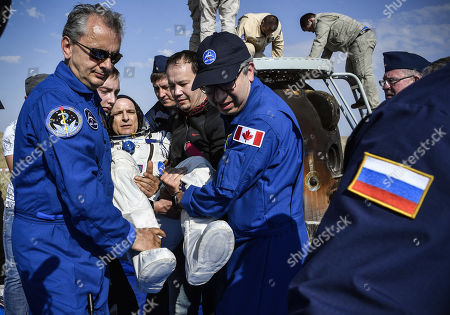 Ground personnel carry David Saint-Jacques of the Canadian Space Agency, shortly after landing in a remote area outside the town of Dzhezkazgan (Zhezkazgan), Kazakhstan, 25 June 2019. The Soyuz MS-11 capsule with the International Space Station (ISS) crew of NASA astronaut Anne McClain, Russian cosmonaut Oleg Kononenko and David Saint-Jacques of the Canadian Space Agency on board landed safely in the Kazakh steppe on 25 June 2019.