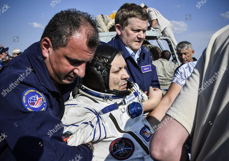 Ground personnel carry Russian cosmonaut Oleg Kononenko shortly after landing in a remote area outside the town of Dzhezkazgan (Zhezkazgan), Kazakhstan, 25 June 2019. The Soyuz MS-11 capsule with the International Space Station (ISS) crew of NASA astronaut Anne McClain, Russian cosmonaut Oleg Kononenko and David Saint-Jacques of the Canadian Space Agency on board landed in the Kazakh steppe on 25 June 2019.