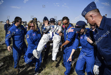 Ground personnel carry NASA astronaut Anne McClain shortly after landing in a remote area outside the town of Dzhezkazgan (Zhezkazgan), Kazakhstan, 25 June 2019.  The Soyuz MS-11 capsule with the International Space Station (ISS) crew of NASA astronaut Anne McClain, Russian cosmonaut Oleg Kononenko and David Saint-Jacques of the Canadian Space Agency on board landed in the Kazakh steppe on 25 June 2019.