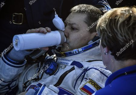 Russian cosmonaut Oleg Kononenko drinks shortly after landing in a remote area outside the town of Dzhezkazgan (Zhezkazgan), Kazakhstan, 25 June 2019. The Soyuz MS-11 capsule with the International Space Station (ISS) crew of NASA astronaut Anne McClain, Russian cosmonaut Oleg Kononenko and David Saint-Jacques of the Canadian Space Agency on board landed in the Kazakh steppe on 25 June 2019.