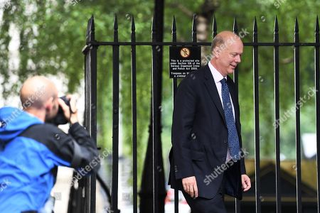 Chris Grayling, Secretary of State for Transport, arrives at No.10 Downing Street