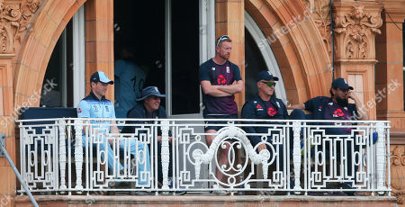 Eoin Morgan (Captain) of England, Trevor  Bayliss & Paul Collingwood  watch from the England  balcony