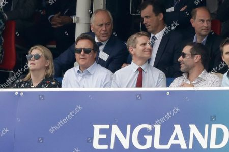 Former British Prime Minister David Cameron, bottom row second left, and Prince Edward, top right, watch from a box during the Cricket World Cup match between England and Australia at Lord's cricket ground in London