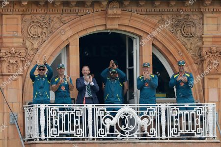 The Australia balcony including coach Justin Langer, left, and assistant coach and former captain Ricky Ponting, second left, applaud after their side took the wicket of England's Jofra Archer during the Cricket World Cup match between England and Australia at Lord's cricket ground in London