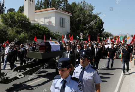 Stock Image of Crowds line the streets as an honour guard and flanks a gun carriage transporting the coffin of former Cyprus President Demetris Christofias during funeral ceremonies as the cortege heads for the Holy Church of God's Wisdom in Nicosia, Cyprus, 25 June 2019. Demetris Christofias was the sixth President of the Republic of Cyprus, died at the age of 72 in a Nicosia hospital 21 June.