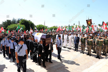 Stock Photo of Honour guards transporting the coffin of former Cyprus President Demetris Christofias during funeral ceremonies as the cortege heads for the Holy Church of God's Wisdom in Nicosia, Cyprus25 June 2019. Demetris Christofias was the sixth President of the Republic of Cyprus, died at the age of 72 in a Nicosia hospital 21 June.