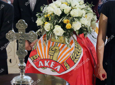 The AKEL communist party flag covers the coffin of the former Cyprus' Demetris Christofias as a member of party stands by during his state funeral at the at the Holy Church of God's Wisdom in Nicosia, Cyprus, 25 June 2019. Demetris Christofias was the sixth President of the Republic of Cyprus, died at the age of 72 in a Nicosia hospital 21 June.