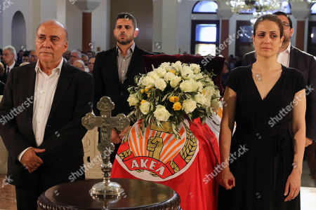 Stock Picture of Members of AKEL communist party stand by the coffin of the former Cyprus' President Demetris Christofias as a member of party stands by during his state funeral at the at the Holy Church of God's Wisdom in Nicosia, Cyprus, 25 June 2019. Demetris Christofias was the sixth President of the Republic of Cyprus, died at the age of 72 in a Nicosia hospital 21 June.