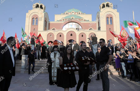 A man and a woman carry the medals in front of the coffin during the funeral of former Cypriot president Demetris Christofias at the Holy Church of God's Wisdom in Nicosia, Cyprus, 25 June 2019. Demetris Christofias was the sixth President of the Republic of Cyprus, died at the age of 72 in a Nicosia hospital 21 June.