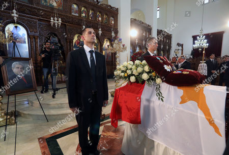 Members of AKEL communist party stand by the coffin of the former Cyprus' President Demetris Christofias as a member of party stands by during his state funeral at the at the Holy Church of God's Wisdom in Nicosia, Cyprus, 25 June 2019. Demetris Christofias was the sixth President of the Republic of Cyprus, died at the age of 72 in a Nicosia hospital 21 June.