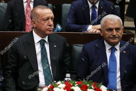 Recep Tayyip Erdogan, Binali Yildirim. Turkey's President Recep Tayyip Erdogan, left, with Binali Yildirim, his mayoral candidate for Istanbul, attends parliament in Ankara, Turkey, two days after Ekrem Imamoglu, the candidate of the secular opposition Republican People's Party, won the election for mayor of Istanbul. Erdogan addressed his AK Party's weekly meeting, the first time he speaks since the Istanbul mayoral election Sunday, which was a big setback for him and his party