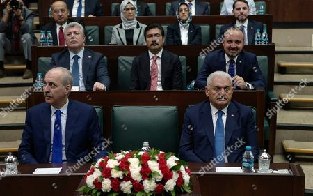 Binali Yildirim, ruling Justice and Development Party's mayoral candidate for Istanbul, front right, listens to President Recep Tayyip Erdogan at the parliament in Ankara, Turkey, two days after Ekrem Imamoglu, the candidate of the secular opposition Republican People's Party, won the election for mayor of Istanbul. Erdogan addressed his AK Party's weekly meeting, the first time he speaks since the Istanbul mayoral election Sunday, which was a big setback for him and his party