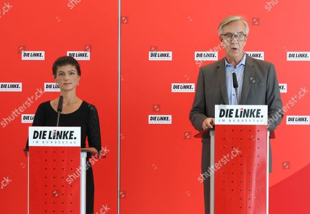 Stock Image of The Left party (Die Linke) faction co-chairwoman in the German parliament Bundestag Sahra Wagenknecht (L) and co-chairman of German The Left party Dietmar Bartsch (R) speak to the media at the German parliament Bundestag in Berlin, Germany, 25 June 2019.