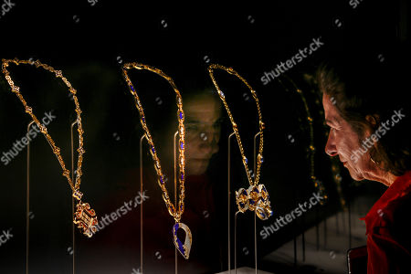 """A woman looks at necklaces on display during a preview of the exhibition """"Bulgari. The story, the dream"""" at St. Angel Castle in Rome, . The exhibition, which is on from June 26 till Nov. 3, 2019 features jewels and vintage haute couture pieces owned and worn by legendary actresses like, ElizabethTaylor, Ingrid Bergman, Sophia Loren, Gina Lollobrigida and Audrey Hepburn"""