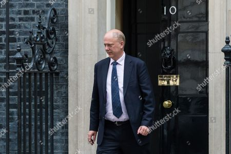 Chris Grayling, Secretary of State for Transport leaves 10 Downing Street after the weekly Cabinet meeting