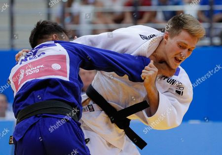 Stock Image of Roy Koffijberg (blue) of Netherlands and Lukas Reiter of Austria compete in the Mixed Team, men's -73kg, bronze-medal contest of the Judo competitions at the Minsk 2019 European Games in Minsk, Belarus, 25 June 2019.