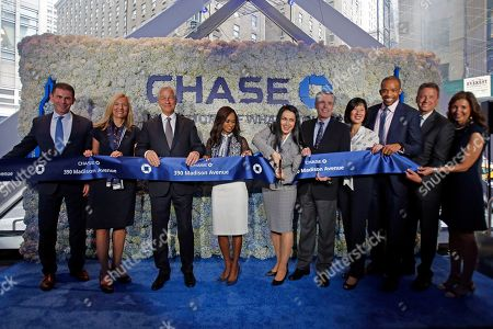 CO- Jamie Dimon, Chairman and CEO, JPMorgan Chase, takes part as the Chase NYC Flagship branch manager cuts the ribbon, in New York