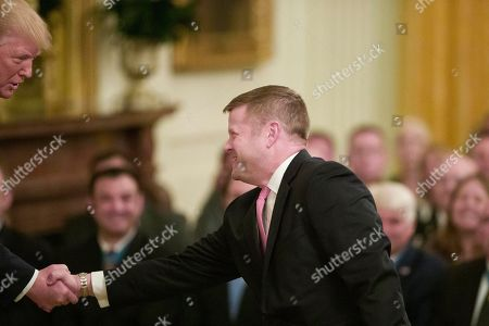 Donald Trump, Ryan McCarthy. President Donald Trump, left, greets Acting Army Secretary Ryan McCarthy before awarding the Medal of Honor to Army Staff Sgt. David Bellavia in the East Room of the White House in Washington, for conspicuous gallantry while serving in support of Operation Phantom Fury in Fallujah, Iraq