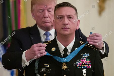 Donald Trump, David Bellavia. President Donald Trump awards the Medal of Honor to Army Staff Sgt. David Bellavia in the East Room of the White House in Washington, for conspicuous gallantry while serving in support of Operation Phantom Fury in Fallujah, Iraq