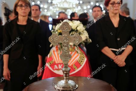 Stock Photo of Members of AKEL communist party stand by the coffin of the former Cyprus' President Dimitris Christofias during his state funeral at the Orthodox Christian Church of the Lord's Wisdom in capital Nicosia, Cyprus, . European communist and left-wing party heads and leaders from ethnically split Cyprus' breakaway Turkish Cypriot community were among those attending a funeral service for the country's former president Christofias