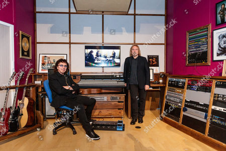 Tony Iommi and Geezer Butler pose in Tony Iommi's home recording studio, transported and recreated in the exhibition space.