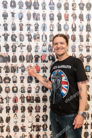 Stock Picture of Chris Hopkins finds his portrait on the wall of Black Sabbath fans