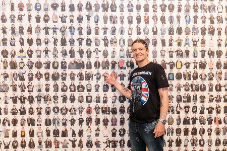 Chris Hopkins finds his portrait on the wall of Black Sabbath fans
