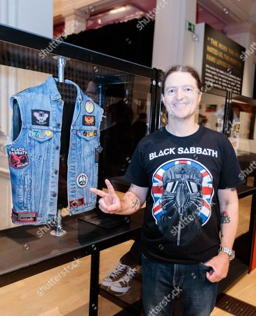 """Stock Image of Superfan Chris Hopkins with one of his many """"Battle Jackets"""" personalised with embroidered patches collected from concerts over decades."""