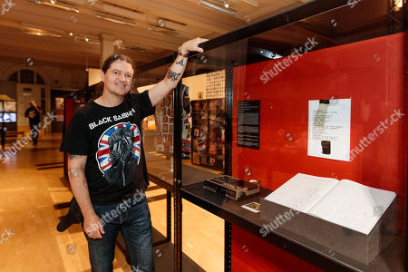 Chris Hopkins with the tape recorder gifted to him as a child, along with the first ever Black Sabbath cassette which started his road to fandom. Also pictured is a ledger book detailing every Black Sabbath related concert he has attended