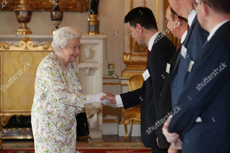 Queen Elizabeth II greets Housing Secretary James Brokenshire during a reception at Buckingham Palace