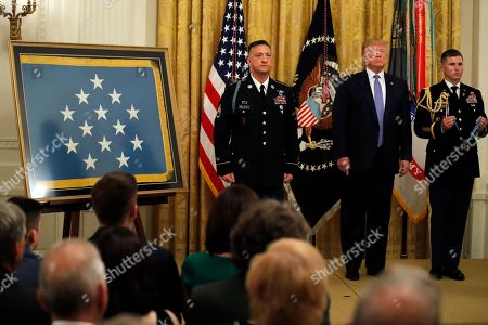 Donald Trump David Bellavia. President Donald Trump stands with Army Staff Sgt. David Bellavia, left, as the citation is read before Bellavia was awarded the Medal of Honor at the White House in Washington, for conspicuous gallantry in support of Operation Phantom Fury in Fallujah, Iraq