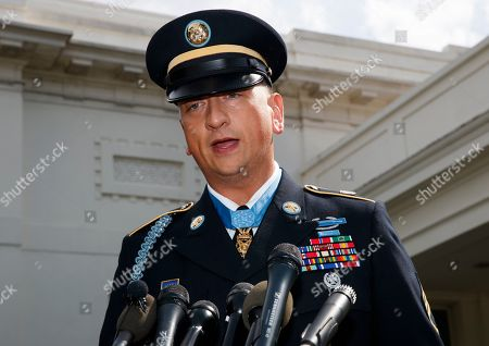 Medal of Honor recipient Army Staff Sgt. David Bellavia speaks to media outside the West Wing of the White House in Washington, after receiving the Medal of Honor for conspicuous gallantry while serving in support of Operation Phantom Fury in Fallujah, Iraq