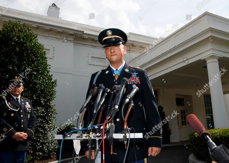 Medal of Honor recipient Army Staff Sgt. David Bellavia pauses as he speaks to media outside the West Wing of the White House in Washington, after receiving the Medal of Honor for conspicuous gallantry while serving in support of Operation Phantom Fury in Fallujah, Iraq