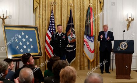 Donald Trump, David Bellavia. President Donald Trump applauds during a ceremony to award the Medal of Honor to Army Staff Sgt. David Bellavia in the East Room of the White House in Washington, for conspicuous gallantry while serving in support of Operation Phantom Fury in Fallujah, Iraq